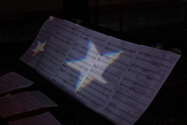 Score of 'By the Water' lit up with the incredible light design work.