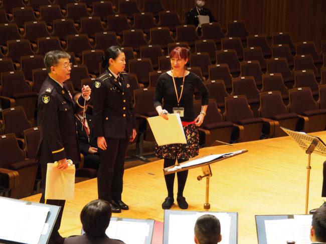 In rehearsal: Beaugeais with Conductor Colonel Takahiro Higuchi & Saxophonist/translator Haruka Ogata